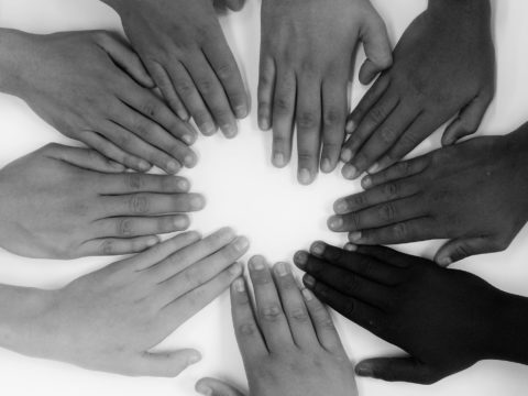 Volunteering, voluntouring, volunteering hands, world peace, hands, united, united nations, colours, circle of hands, black and white