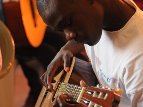 volunteer, music teacher, volunteering, Africa, teaching Music abroad, teachers, teaching, education, Music, guitar, acoustic guitar