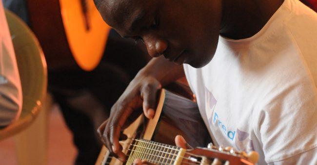 volunteer, music teacher, volunteering, Africa, teaching Music abroad, teachers, teaching, education, Music, guitar, acoustic guitar